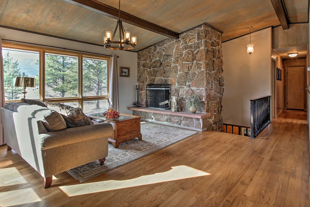 Enjoy a good book or game in front of the large moss rock fireplace.