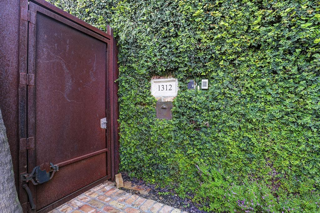 Security gate controls entry to the premises. Clicker or code access capable.