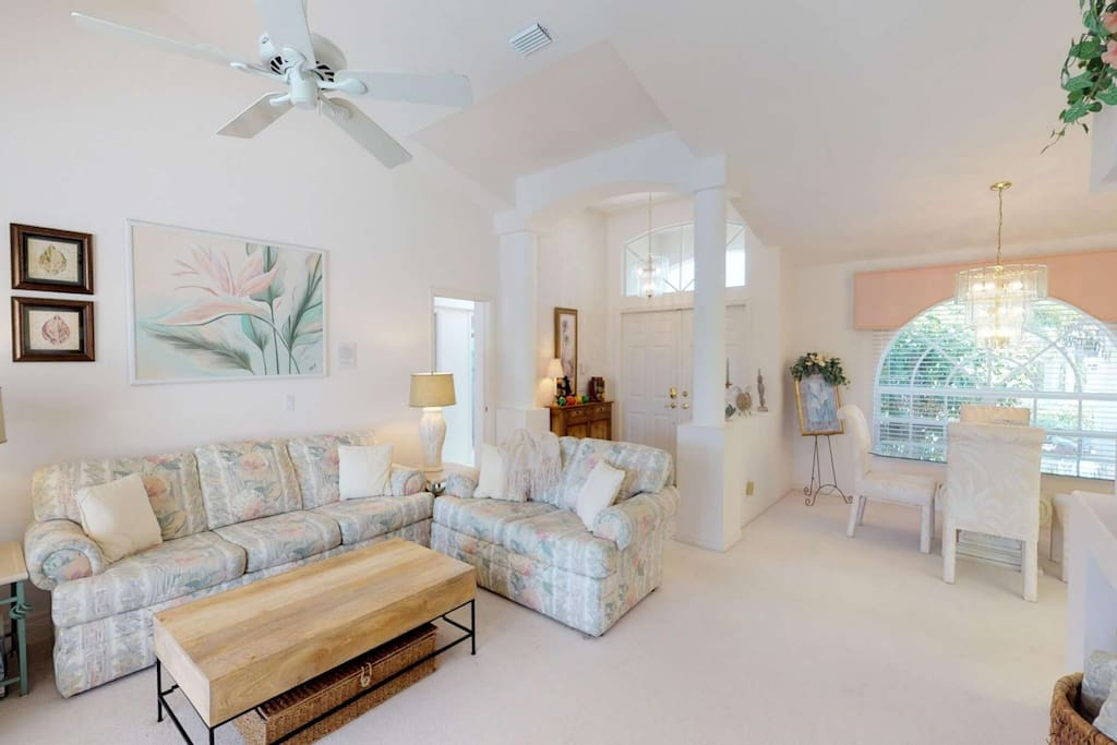 This charming open concept living space is decorated in soft, soothing pastels, and comfortable furnishings, perfect for relaxing.
