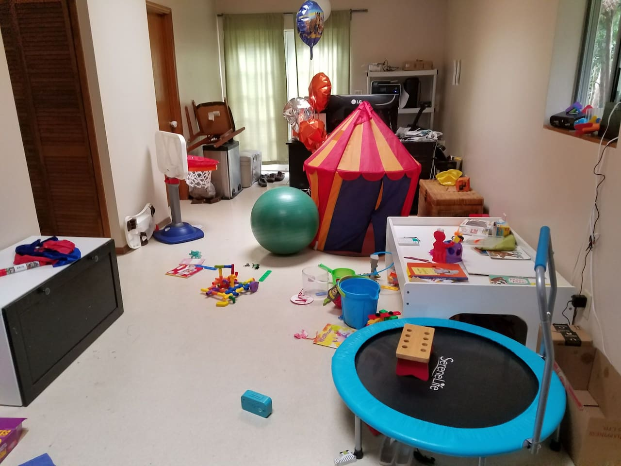 playroom can be converted into a living room/extra bedroom