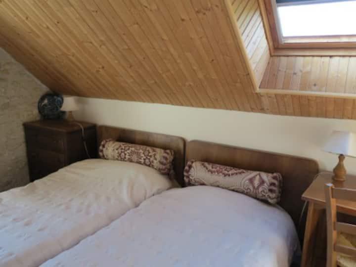 Chambre au 2e étage d'une ancienne ferme