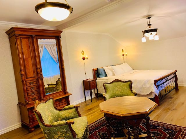 Sofia, a room with queen size bed and bathtub