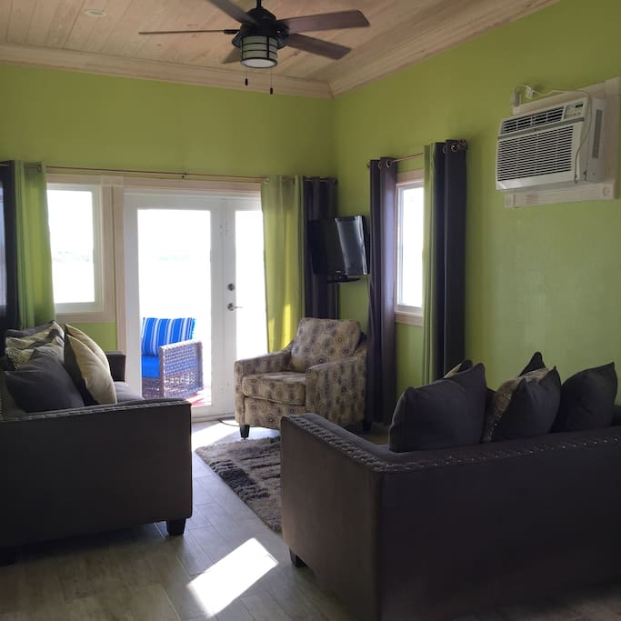 Living room, opens up to front deck.