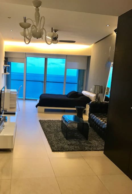 Room 2 sea view with sofa and workplace, full bathroom