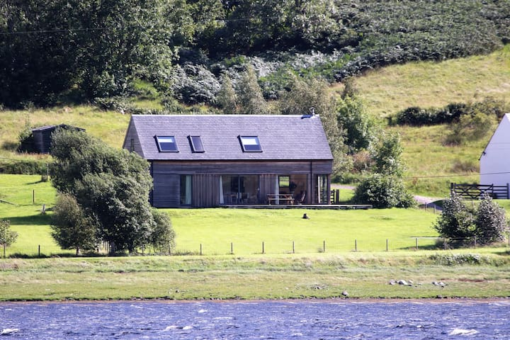 Very large enclosed grassed front garden, with stunning Loch views, ideal for children and dogs to play in