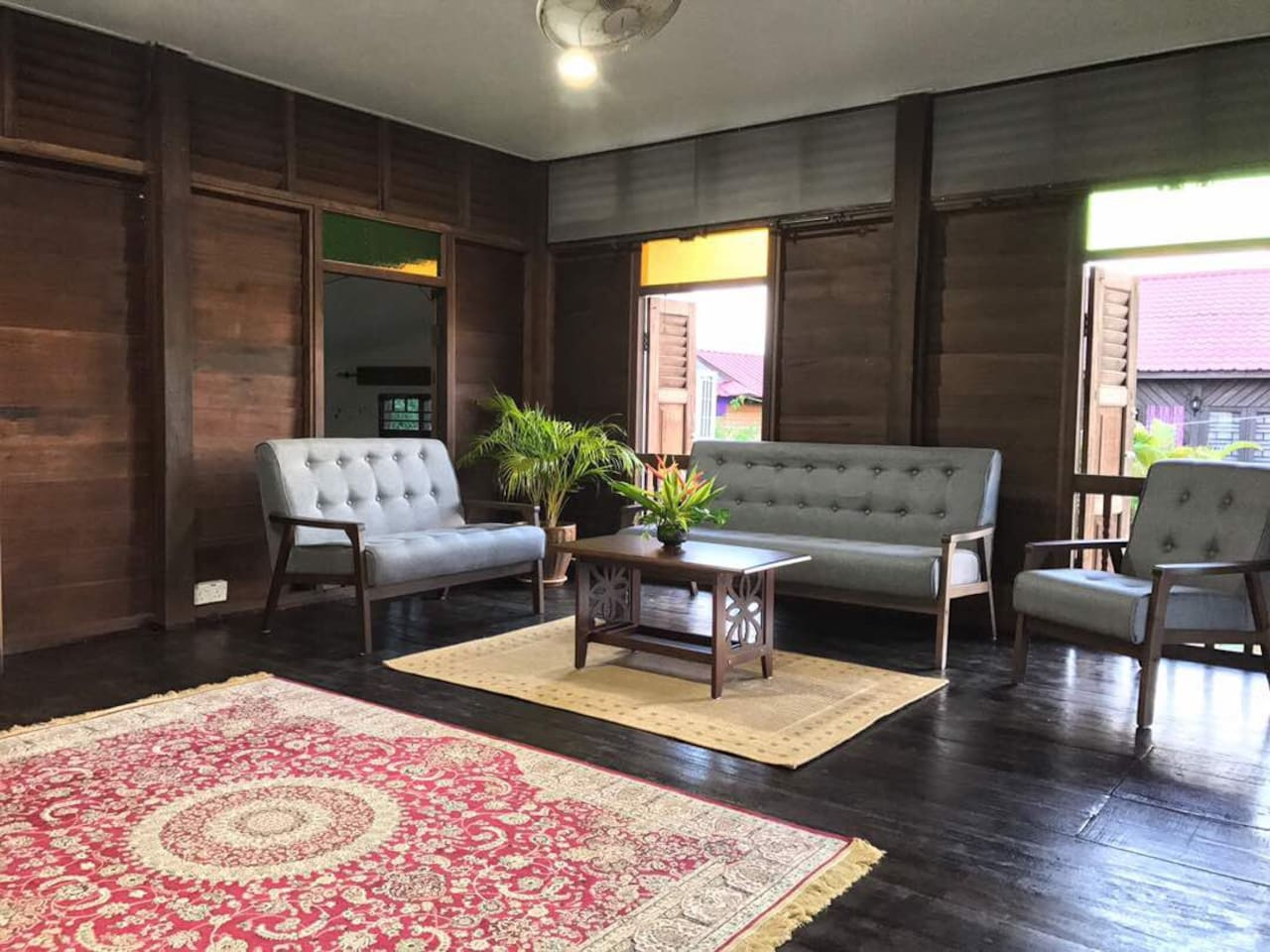 Bright and spacious common area decorated in traditional Malaysian style