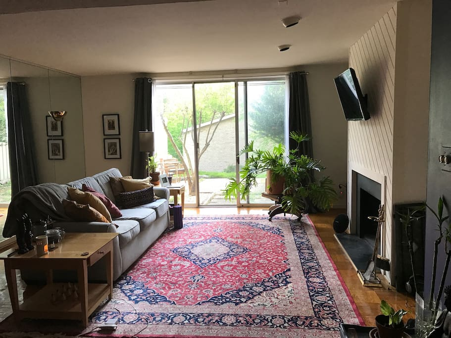 Sunny living area with TV