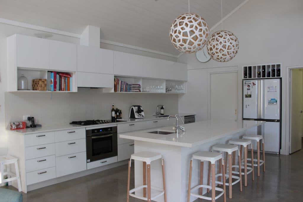 Gourmet kitchen  featuring Highland gas and induction stove tops and large oven. Thermomix and nespresso coffee machine.