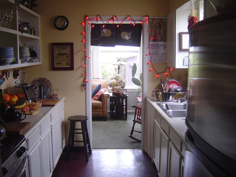 Our kitchen with full sized oven, stove top, microwave and toaster oven