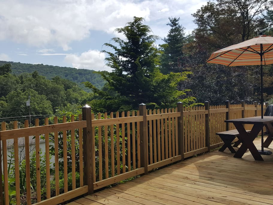 Capture the view from the huge new deck that wraps around the front of this sunny cottage.