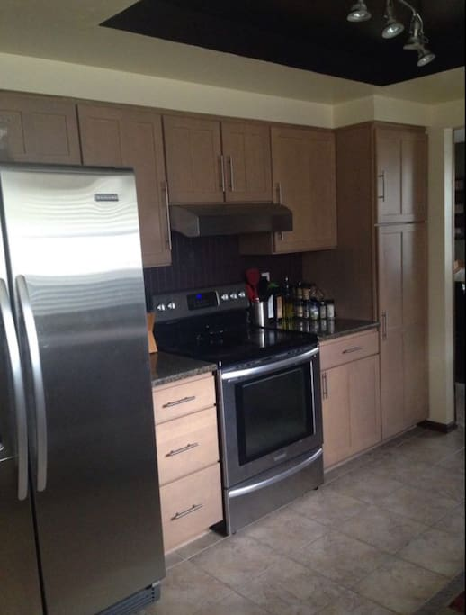 Kitchen with all basic cookware, utensils, spices, and cooking supplies available for your use. Coffee maker available.