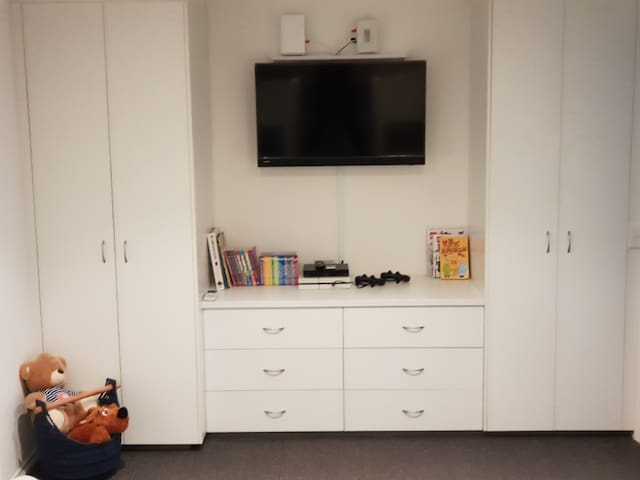 This is a photo of the Bunk room's TV, playstation, DVD and draws with lots of games, puzzles etc.. FUN FUN FUN