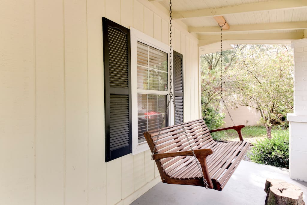 Enjoy your mornings with a cup of coffee on our front porch swing.