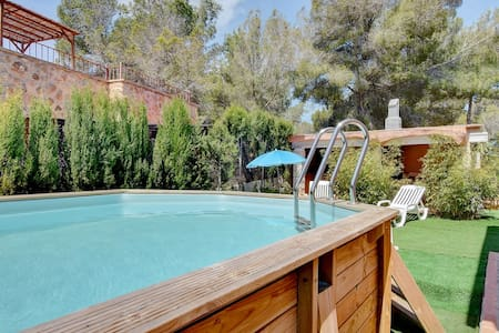 Villa Ca els Avis with above ground pool, garden, and a BBQ house