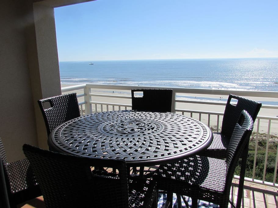 Dining table seats 6 on covered balcony-direct ocean view