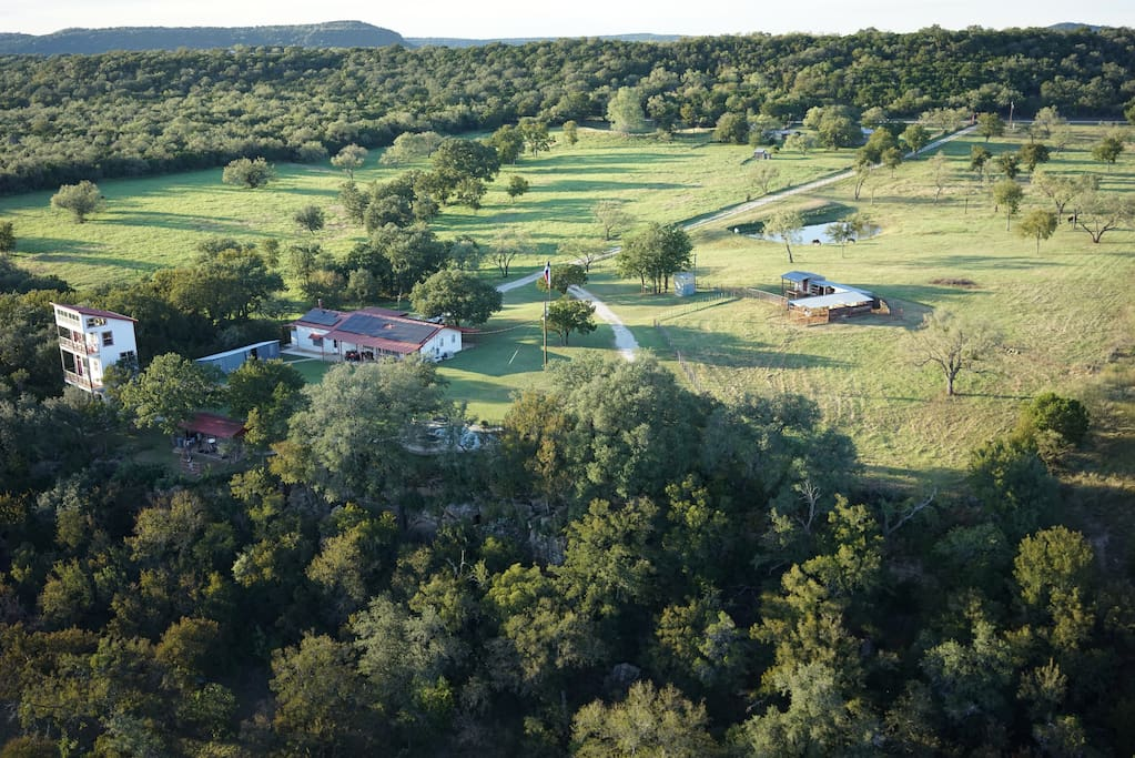 Aerial view of the main house, lookout (not for rent)  and surrounding pastures.