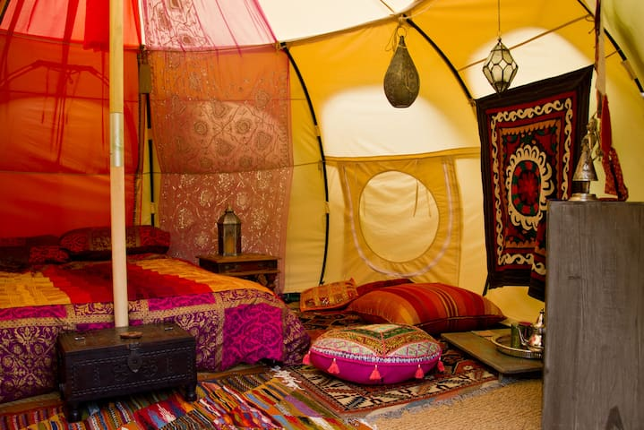 Lots of authentic rugs, Sabre silk scatter cushions, throws and Moroccan lanterns