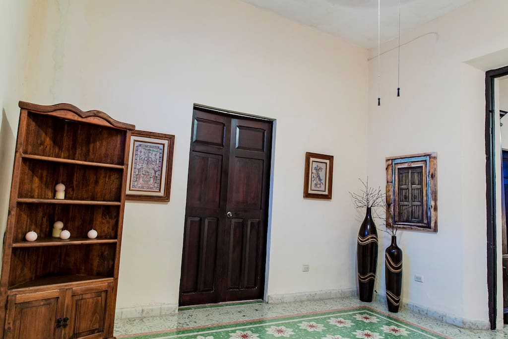 Front entrance room.  The colonial doors to the left give access to the front bedroom.
