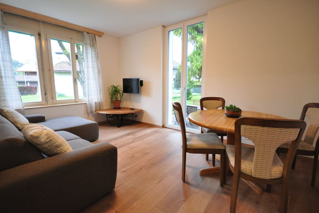 Comfortable sofa and dining for 4.  Doors leading onto garden.