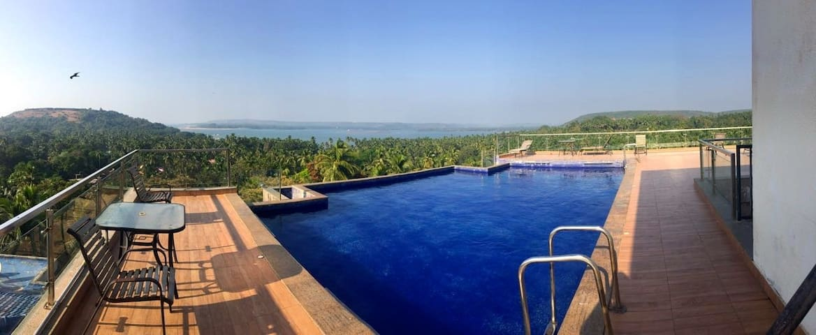 Rooftop Pool View with an observation deck and a panoramic view of the Chapora fort and the river meeting the ocean. Great for beautiful sunsets.