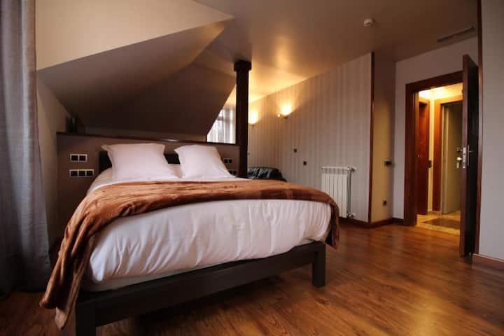 Suite bañera hidromasaje-cama extragrande