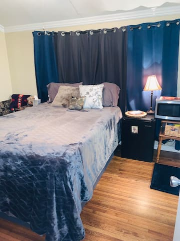 Cozy room, attached bathroom, & amenities
