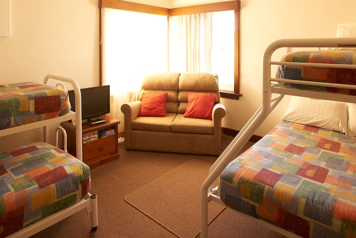The bunkroom can sleep a total of six. There is the double with single above, a double bunk and the couch folds out to a single bed also.