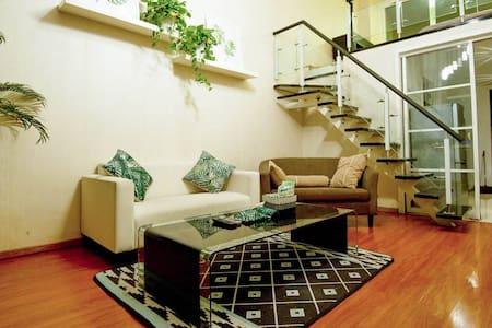 森丛小憩--天塔附近Loft观景复式公寓 - Tianjin - Hotellipalvelut tarjoava huoneisto
