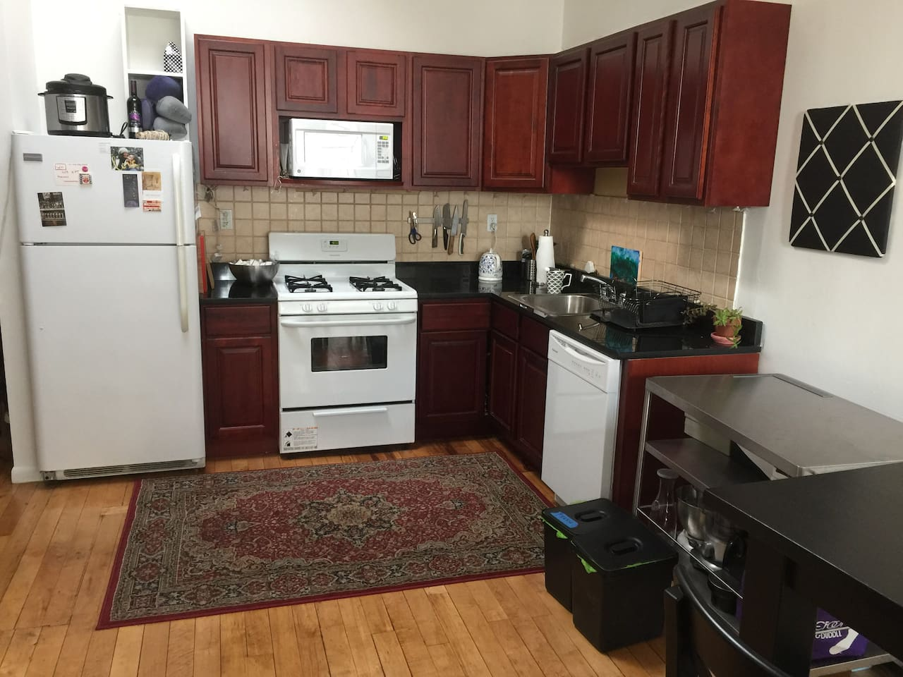 Full kitchen. There is a blender, food processor and stand mixed. Appliances include a microwave and dishwasher.