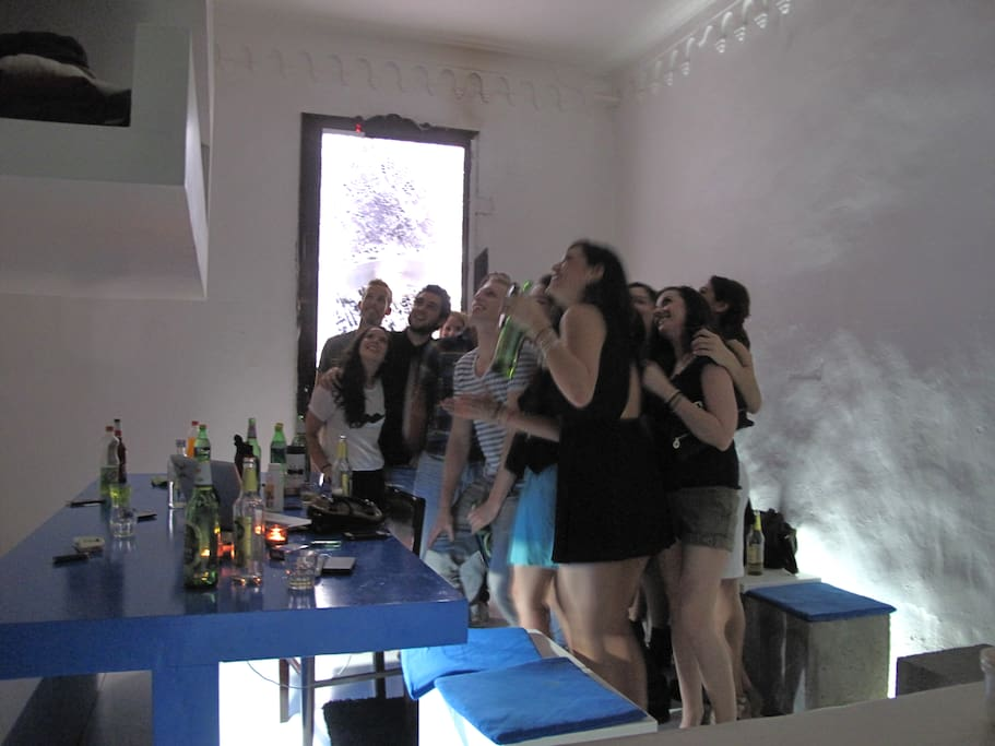 Guest having a party and photographing guests from the upper bunk bed.