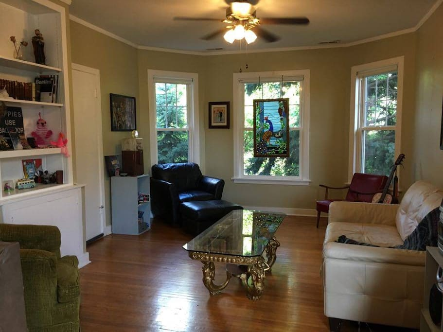 "Tons of natural light. Huge living room has a 37"" TV with cable, two ceiling fans, and many comfy couches and chairs."