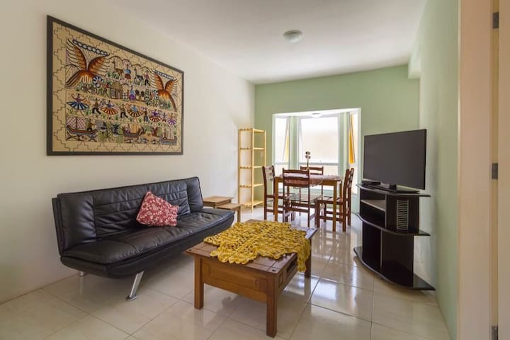 Elegante apartamento na praia com ar condicionado