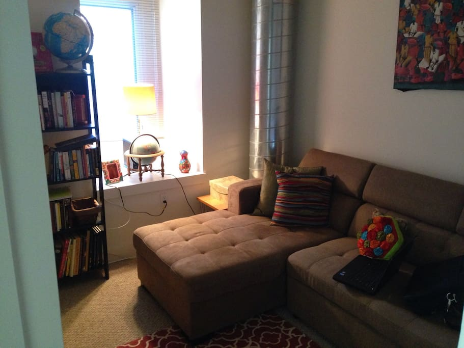 Den with couch that transforms into a queen-sized sleeper for a third guest.