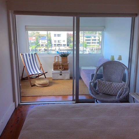 Private glass enclosed sunroom off bedroom.