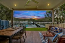 access to the deck that is attached to the main house for outdoor dining, with tranquil views over the water