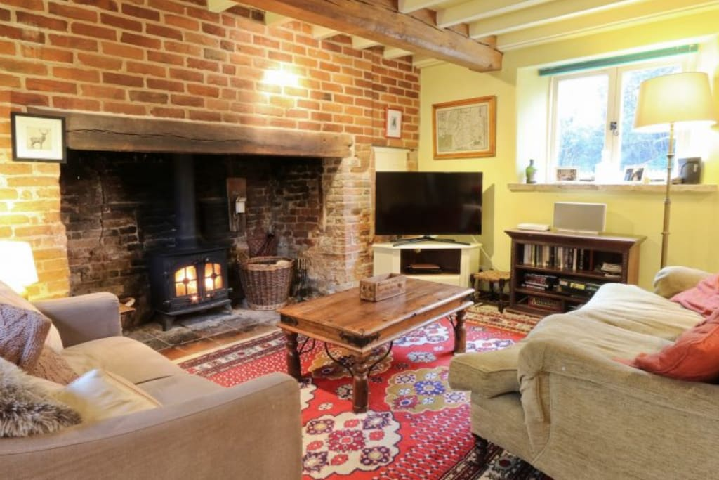 Cosy sitting room, large inglenook fireplace with wood burning stove