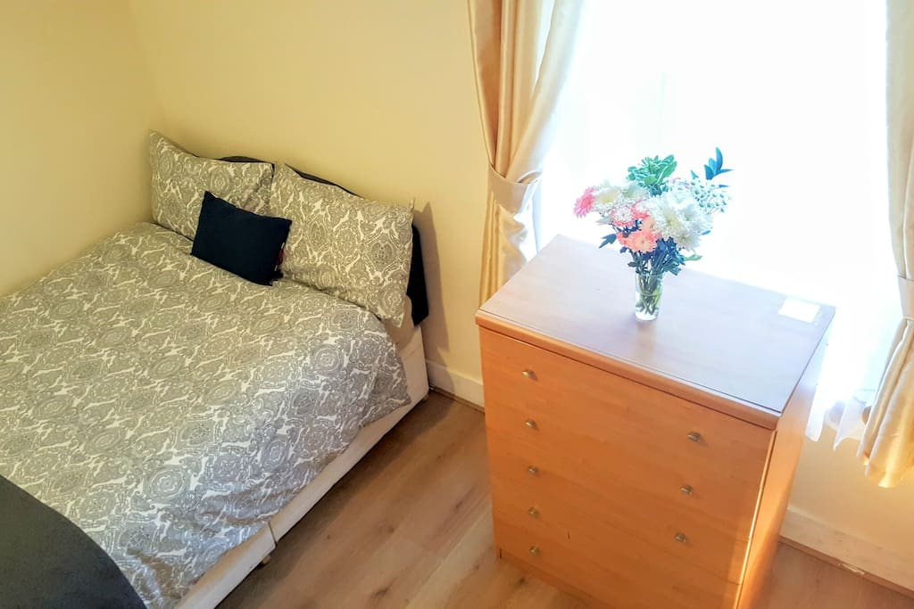 Nice size double bed in a  spacious room