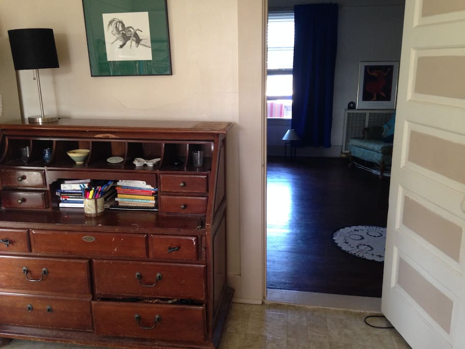 Desk for writing near doorway to the bedroom area