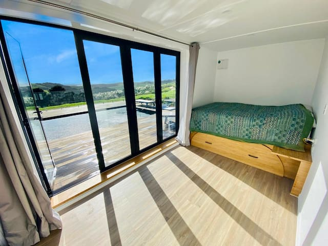 Bedroom by the pool  Features a high, homemade bamboo double bed with lots of storage underneath.