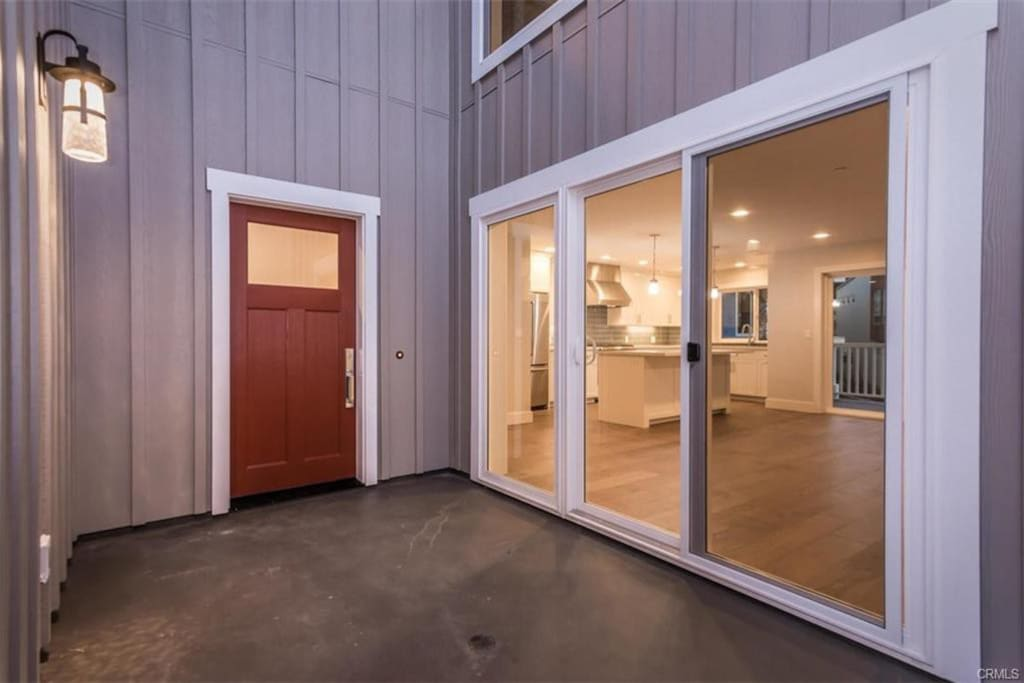 Front entry. Living room has two large sliding doors for a nice cross breeze