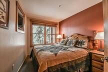 A big bed perfect for relaxing after a long day and a great view with natural lighting