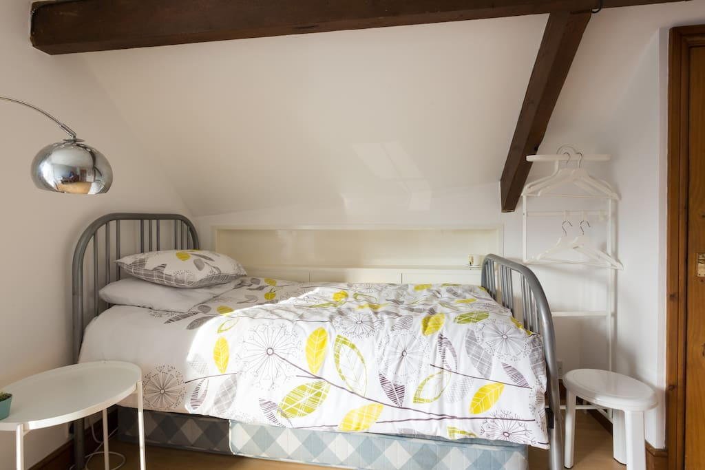 Large single bedroom on 2nd Floor showing hanging space, bedside table and lamp