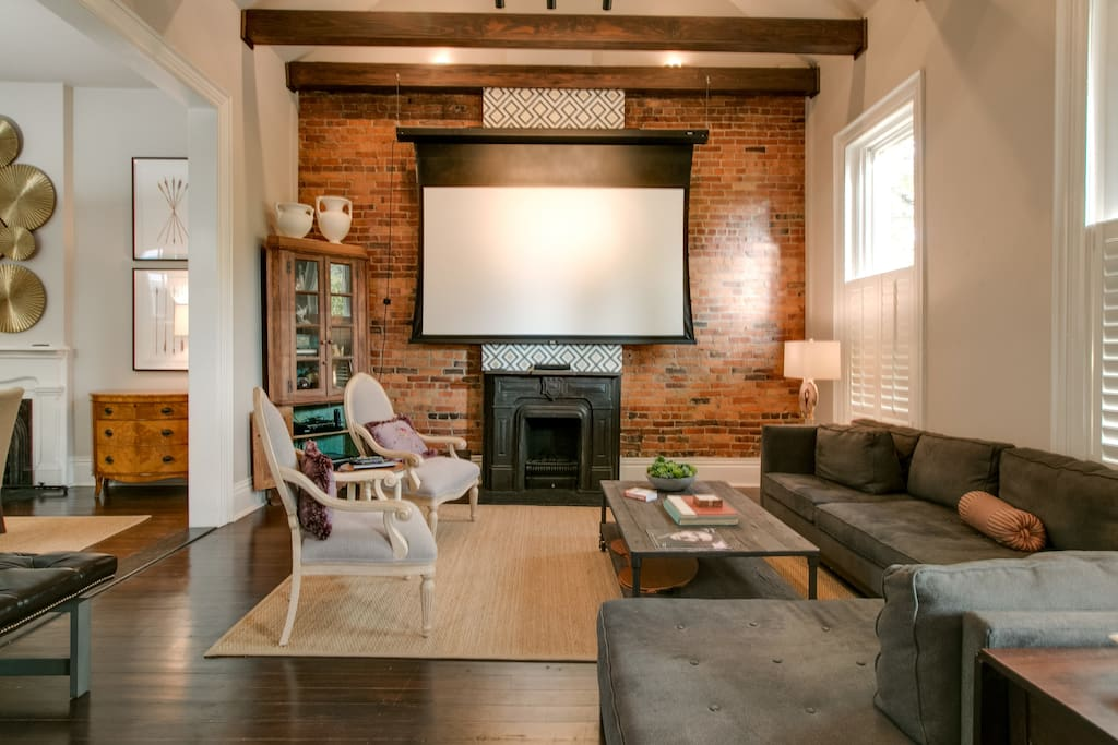 The airy living room has an in-home theater and stereo system.