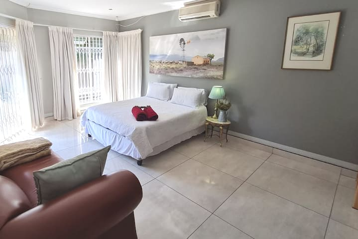 Large main bedroom with aircon, garden view and on suite bathroom.