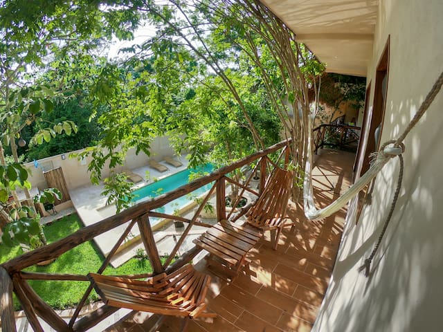 Private balcony, set of chairs, table and a comfortable double hammock.