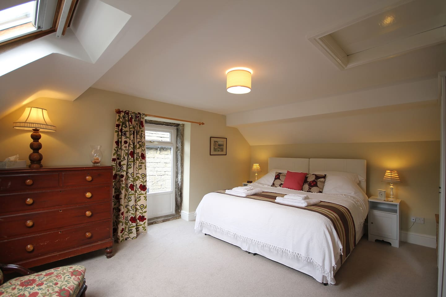 The super-king size bed can also be made into twin beds- towels provided.