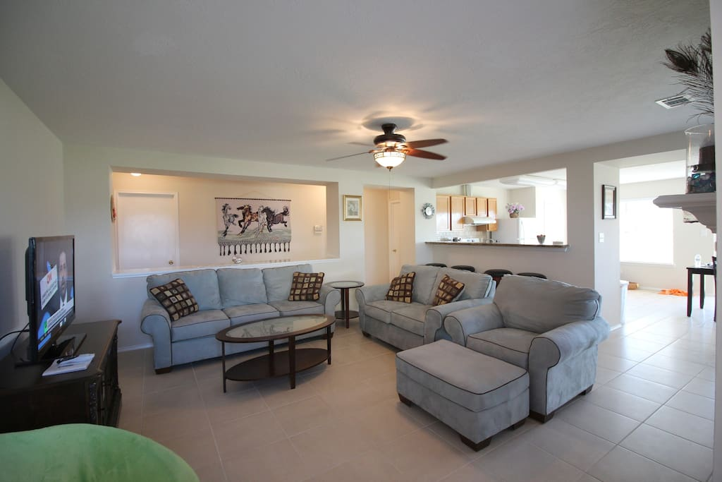 Step inside into an open and bright living room with views of the lake,  a fireplace,  a TV with 150 channel choices. Free WIFI available in all rooms.