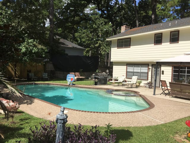 Salt water pool with jacuzzi. Back yard bbq (dual gas and charcoal), and ample seating.