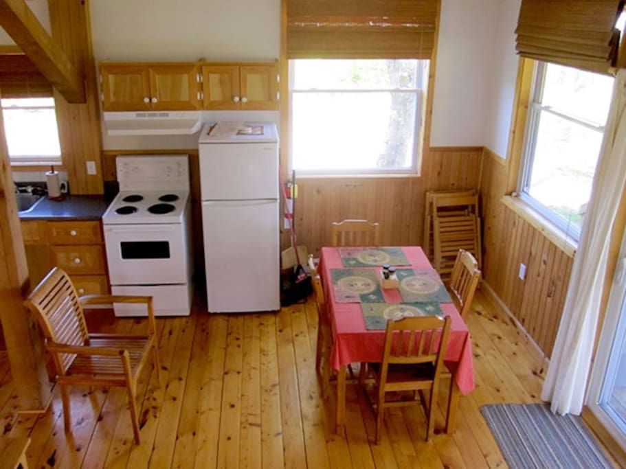 Step in and you are in the kitchen and living room with a wood stove.