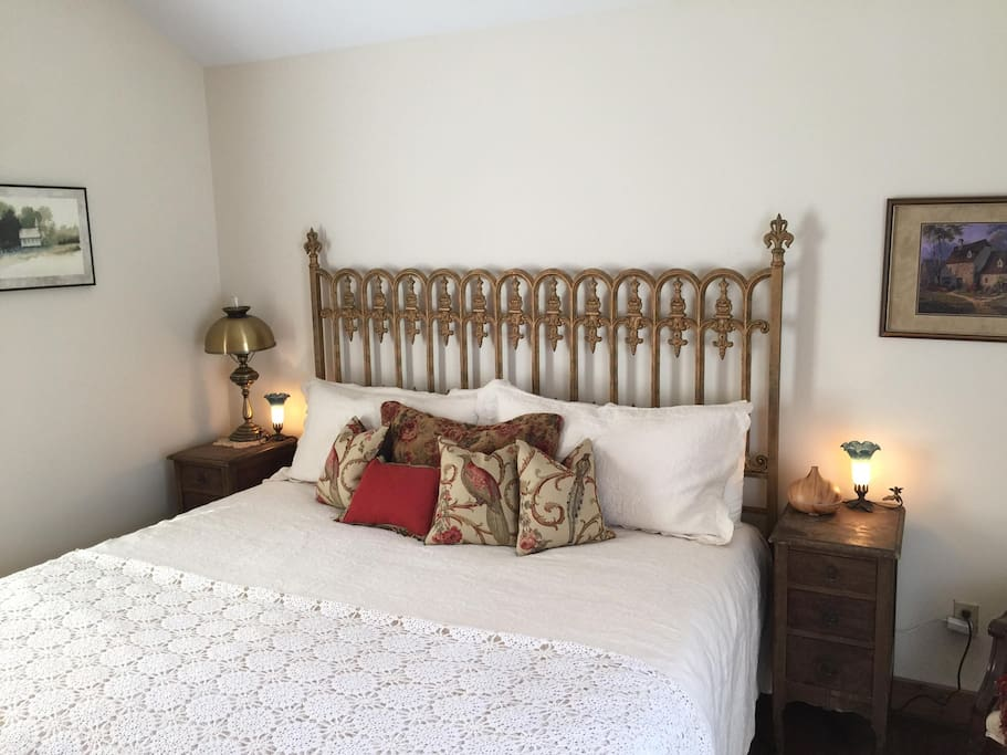 Cozy king bed with clean sheets and optional essential oil diffuser.